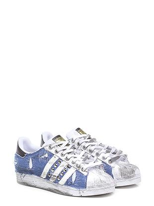 Sneaker ripped denim